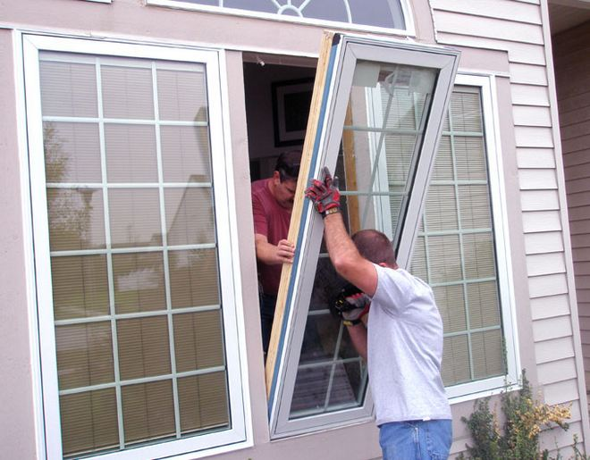 insured window specialist installing customers windows near Conshohocken Pennsylvania