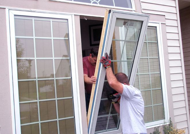 licensed window contractor installing customers windows near Folsom Pennsylvania 19033