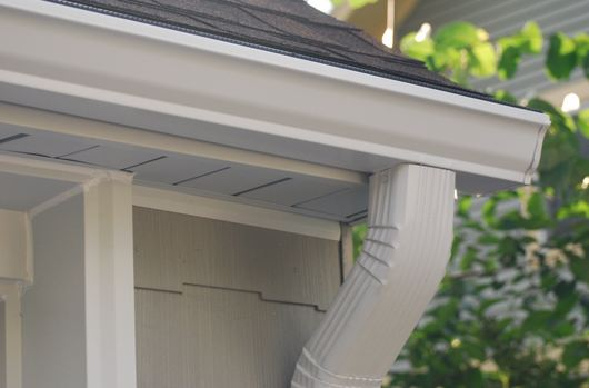 affordable gutter expert installing clients gutters in Gwynedd Pennsylvania 19436