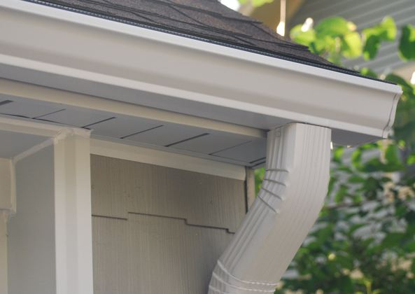licensed gutter specialist installing clients gutters in Elkins Park PA