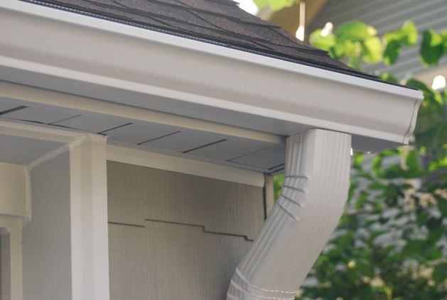 professional gutter contractor installing clients gutters near Zieglerville PA