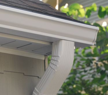 professional gutter expert installing customers gutters near Cheswold Delaware