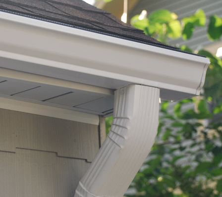 insured gutter contractor installing gutter system in Huntingdon Valley PA